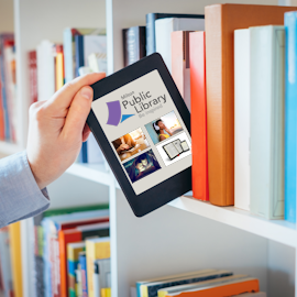 Academic places an e-book on library shelf in between traditional books