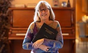 Cheerful female academic holding onto her manuscript