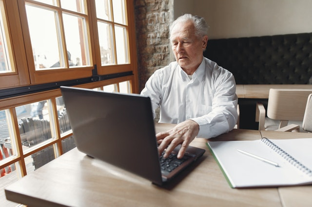 Academic engages in research using his personal computer