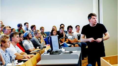 Professor delivers a lecture to students