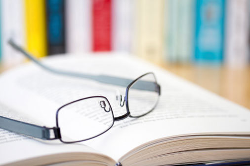 An open book lies on a table