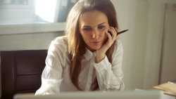 Woman looks intently at computer