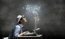 Academic mesmerized as magic dust ascends from his typewriter