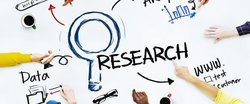 Academics point to the words 'research' and 'data' on a virtual poster