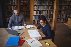 Academics carry out research in library