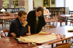 Professors meet in university library to discuss a project