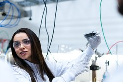 Female scientist conducts experiment in laboratory