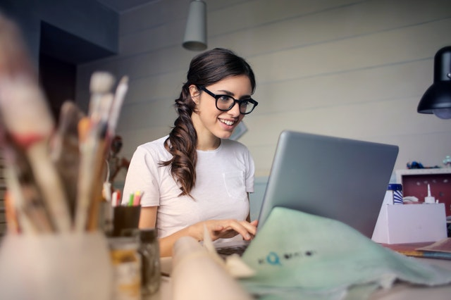 Cheerful female academic conducts research online